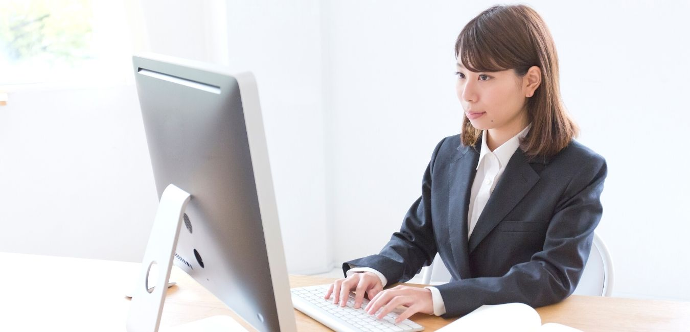 Girl on computer doing SEO to help business growth